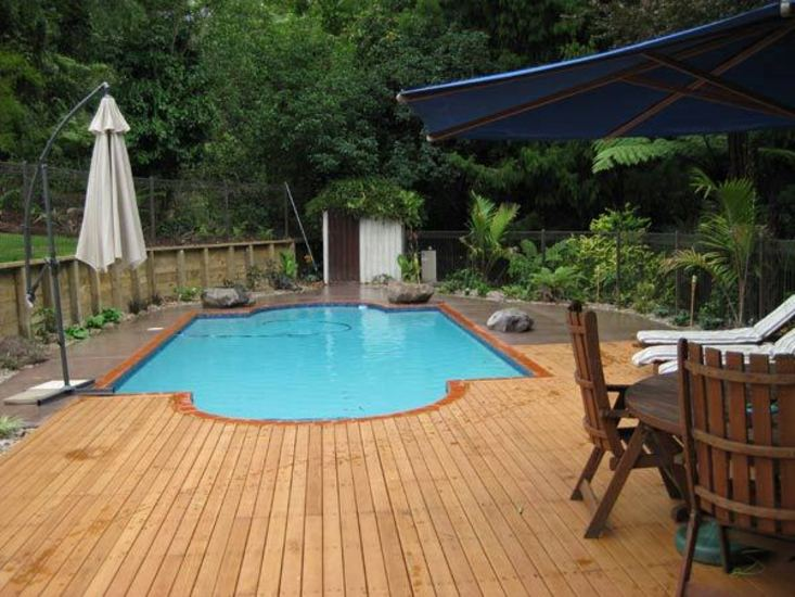 Swimming-Pool-with-feature-Timber-Deck-and-Coloured-ConcreteCloseup-of-Deck-Around-Pool-and-concrete