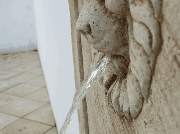 Close-up- of-Lion's-Head-for-classical-water-feature-and-feature-paving