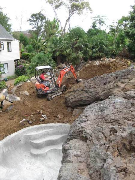 Excavator-Moving-Rocks-and-Soil-from-Pool-Dig-Out-new-garden-makeove