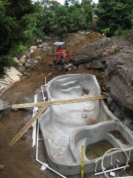 Excavator-Moving-Rocks-and-Soil-for-New-Patio-and-Paths-landscaping-design