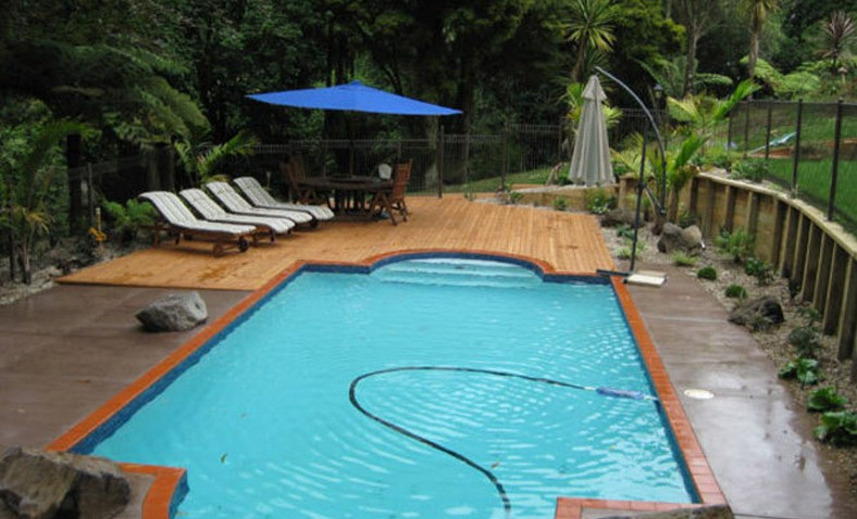 Swimming-Pool-with-feature-Timber-Deck-and-Coloured-Concrete
