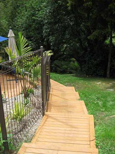 Timber-Cascading-Steps-around-pool-landscaping-solutions